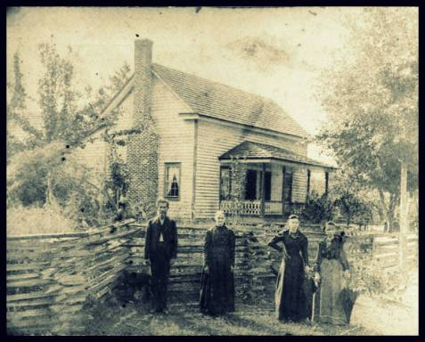 Left to right: James Henry Swindle, Nancy Jane Parker Swindle, Harriet Swindle, Martha Ada Swindle. The home was located about two miles outside Ray City.