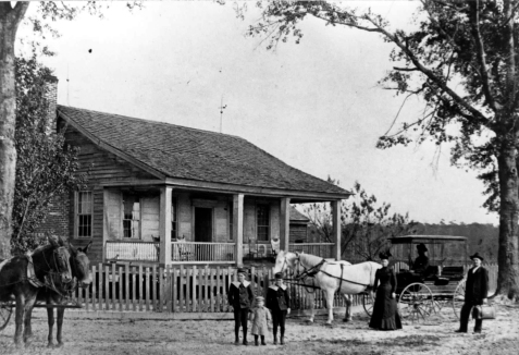 Home of Fannie Hagan and James B. Baskin  circa 1900. The home was located near Ray City, GA on the Howard Boyett farm in today's Lanier County. Left to right: Armstrong B., J Hagan, Ernest L, Fannie and James B. Baskin.