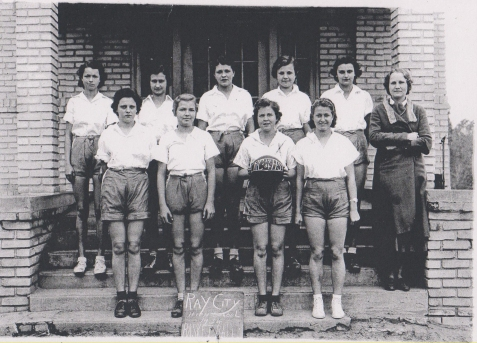 1934 Ray City School - Girls Basketball Team (Left to Right) Front Row: Johnnie Sirmans, Grace Clements, Louise Paulk, Winona Holiday. Back Row: Helen DuBose, Clyde Carter, Jimmie Johnson, Helen Swindle, Virginia Studstill. Coach: Jesse Webb.