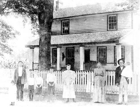 Henry Harrison Knight Family circa 1896, located at Ray's Mill.  L-R, Rosa, unknown, E. M Knight, John T., Alexander, Leila, Mary Ray Knight (mother), and Henry Harrison Knight (father), holding Levi, Jr.