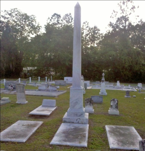 The graves of James Madison Baskin (1829-1913) and his two wives, Frances J. Baskin (1833-1885) and Mary A. Baskin (1859-1917). The obelisk marking the three graves is the largest monument in Beaver Dam Cemetery, Ray City, GA.