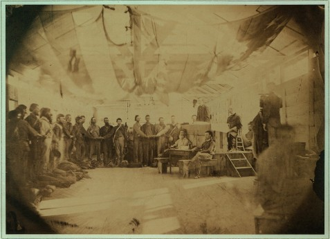Prisoners at Point Lookout, MD taking the oath of allegiance. A group of prisoners stand in a building, with the U.S. Flag draped across the ceiling, each with his hand on a Bible. A Union officer stands at a dias administering the oath of allegiance to the Union. Image courtesy of Civil War Treasures from the New-York Historical Society, [Digital ID, nhnycw/ae ae00007] http://memory.loc.gov/ammem/ndlpcoop/nhihtml/cwnyhshome.html