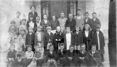 Ray City School photographed in the early 1920s. Identified: Second row 3rd from the right, Ida Lou Giddens Fletcher. Top row 2nd from the right, Ralph Sirmans. Image courtesy of Berrien County Historical Society http://www.berriencountyga.com/