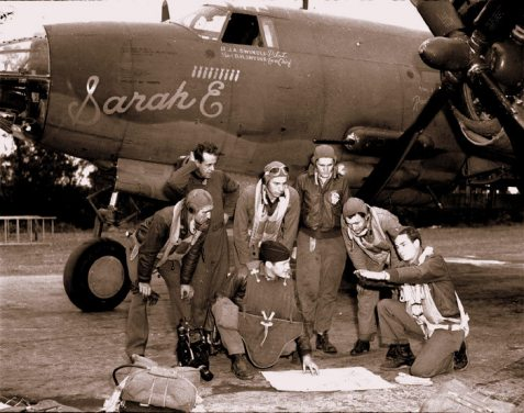 "James A. Swindle (far right, kneeling) with his crew in front of the ""Sarah E"".  The names of Lt. J.A. Swindle, Pilot, and Tech Sgt. D.H. Snyder are visible on the fuselage below the cockpit. Image Source: Ron O'Neal."