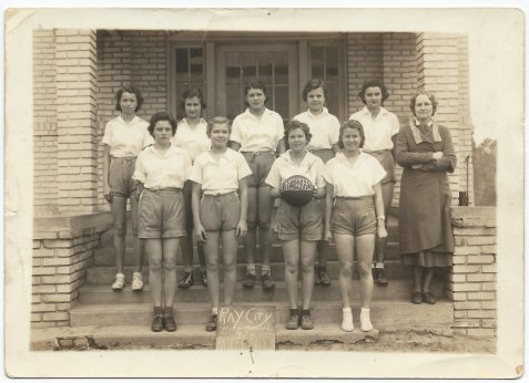 1934 Ray City School, Girls Basketball Team. (Left to Right) Front Row: Johnnie Sirmans, Grace Clements, Louise Paulk, Winona Holiday. Back Row: Helen DuBose, Clyde Carter, Jinnie Johnson, Helen Swindle, Virginia Studstill.