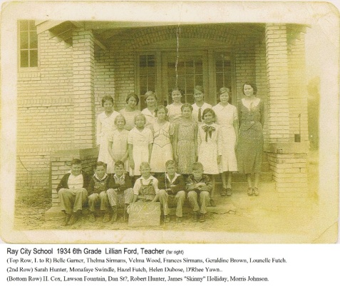 "Ray City School, Ray City, GA. 1934 6th Grade Class. Lillian Ford, Teacher. (Top Row, L to R) Belle Garner, Thelma Sirmans, Velma Wood, Frances Sirmans, Geraldine Brown, Lounelle Futch. (2nd Row) Sarah Hunter, Monafaye Swindle, Hazel Futch, Helen Dubose, D'Ree Yawn. (Bottom Row) H. Cox, Lawson Fountain, Dan St?, Robert Hunter, James ""Skinny"" Holliday, Morris Johnson."