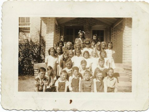 "Ray City School 4th Grade Class Photo, Believed to be Spring 1934. Photo was inscribed on back "" Mildred's 4th Grade Class, Ray City School."" The reference may be to Mildred Clements, who graduated in 1939."
