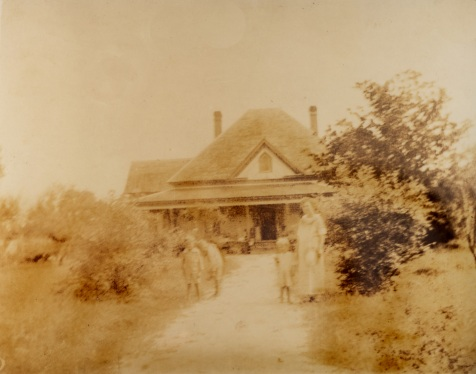 Johnson Homestead near Ray City, Georgia circa 1923. Depicted are Chloe Gardner Johnson and her three youngest children- Robert Bruce Johnson, James Howard Pascal Johnson and Maurice (Morris) Johnson. Image courtesy of Julie Hutson.