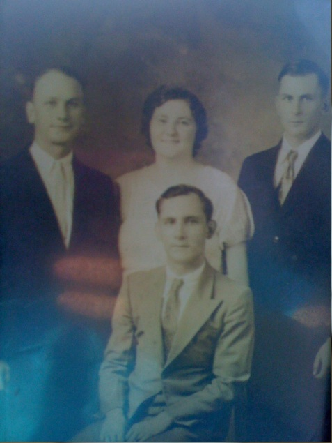 Children of Creasy Brown and George Washington Wood. Left to right: Gruvey Silas Wood, Hattie Wood, Remer Wood, and Leon Wood (seated). Image courtesy of Katie Frost.