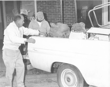 Billy Clements (left) on Main Street outside the Victory Soda Shop after the Ray City fire of March 1969. Image courtesy of berriencountyga.com