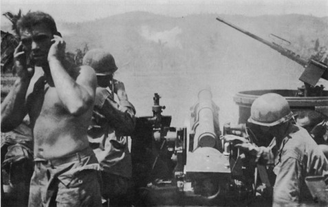U.S. howitzer fires on Catmon Hill, Leyte, Phillipines. October 20, 1944.