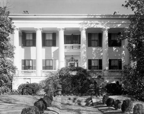 View of the exterior of the Holt - Peeler House, Macon, Bibb County, GA, built by Judge Thaddeus Goode Holt in the 1840s. Judge Holt served on the Southern Circuit of Georgia, and is said to have presided at the first session of Superior Court in Lowndes County, GA in 1825.