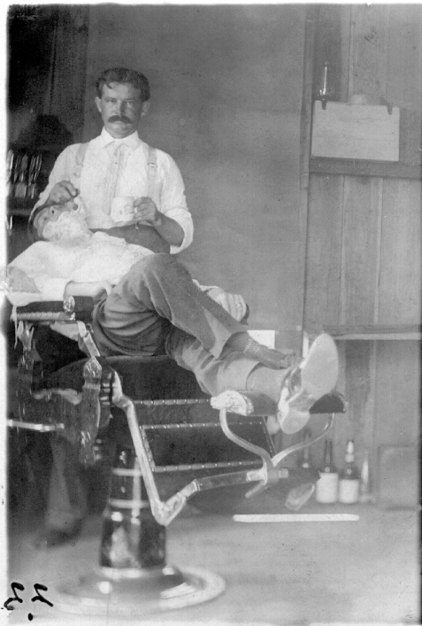 Lyman Franklin Giddens 1876-1963 in his barber shop in Ray City. He served in many capacities for the Ray City community including Justice of the Peace and Mayor. Image and caption courtesy of berriencountyga.com