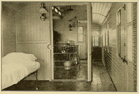 Fig. 5. - 1899 Hospital Car (Plant System, Fla.), looking from the transportation room into the operating room, showing operating table and other arrangements; also shows the passageway to the opposite end of the car.