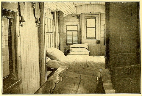 Fig. 6. - 1899 Hospital Car (Plant System, Fla.), looking from the operating room into the transportation room, showing beds made up ready for occupancy.