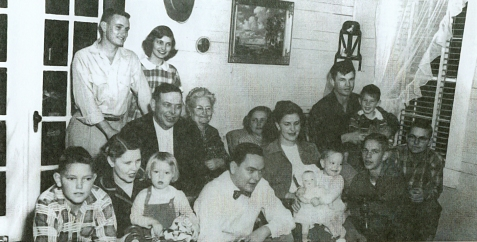 Skinner Family Christmas, 1953. Photographed in the living room of the family home at Allenville, about 4 miles north of Ray City, GA. (L to R) Front row: Jack Skinner, Pauline Riel, Teresa Hendley, William Skinner, Bettie Skinner, Cathy Skinner, George Skinner, Albert Skinner. Back Row seated: David Jackson Skinner, Nettie Akridge Skinner, Kathleen Skinner Hendley, Hilton Hendley, Archie Hendley. Rear, standing: Charlie Skinner, Eloise Skinner Nash.