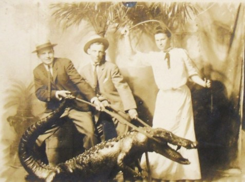Roping  a gator - vintage studio photo postcard.  Image source:  http://postcardiva.blogspot.com/2012_04_01_archive.html
