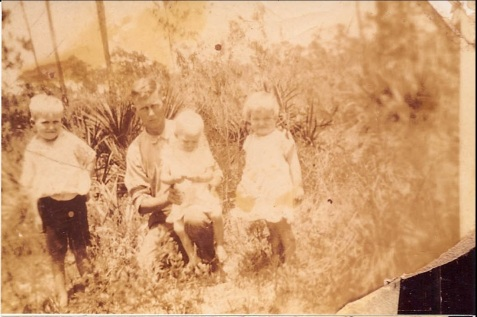 "Lester Griffin and Children, circa 1925-1926. (L to R) Noah Webster ""Webb"" Griffin, Lester holding daughter Ommie, and Audrey. Image courtesy of Alan K. Griffin."