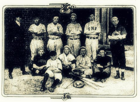 Nashville High School Nine.  The players in the photo are, left to right: Standing, Dewey Knight, Sub and coach; Noble Hull, pitcher and manager; Emory Gary, first base; Robert Hendricks,second base; June Norwood, short-stop; Willie Peeples, catcher and captain.  Sitting: Homer Connell, centerfield; Lucius Griner, mascot; Basom Webb, left field; Hobart Alexander, third base; Alvah Webb, right field.
