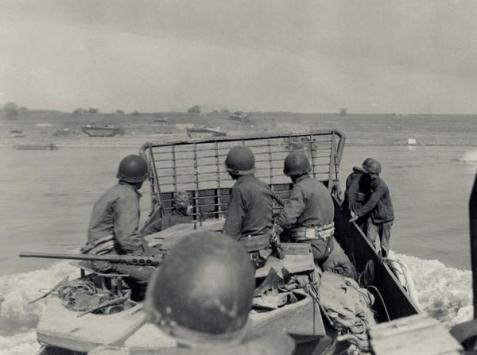 U.S. 79th Division soldiers atop an armored vehicle ride across the Rhine in an LCM on March 24, 1945.  National Archives