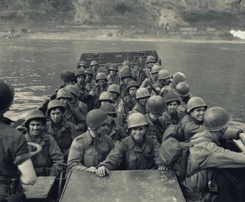 U.S. Third Army infantrymen are ferried across the Rhine in a Navy LCVP near Boppard, Germany, on March 25, 1945.