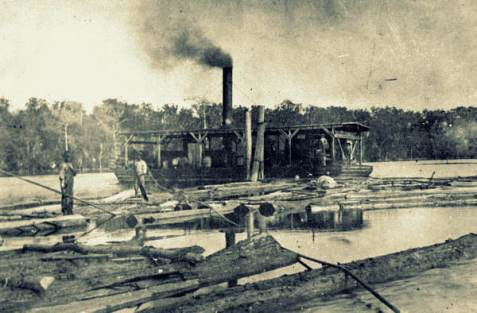 Wilson Cypress Company logging operation on a tributary of the St. Johns River. State Archives of Florida, Florida Memory, http://floridamemory.com/items/show/38992