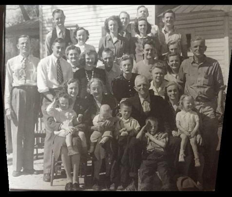 "Family of Maxie Snead Patten <br>Front row: Maxie Snead Patten holding Reba (her daughter), Laura Youmans Snead (holding baby), William M. ""Bill"" Snead, little boys are David Lovett and Jimmy Lovett, Inez Snead Lovett, holding granddaughter, Jan Lovett. <br>2nd Row L-R: Henry Snead, Billy Snead, Annette Snead Ensley (Billy and Annette's father was Walter Snead, one of the 8 Snead siblings, who died in his late twenties, when his children were young.), Myrt Snead Willis, Willie Mae ""Bill"" Sapp, Eugene Lovett (Inez's husband). <br>3rd Row L-R: Dorothy Snead (wife of Felton ""Crip Snead), Tom Skinner, Mary Lovett Skinner. <br>4th Row L-R: Arlo Snead (wife of Henry Snead), Martha ""Boots"" Lovett Paulk, Martha Jim Lovett (wife of James Lovett). <br>Back Row L-R: Grover Patten (husband of Maxie), Colonel Dewitt Sapp, Felton ""Crip"" Snead, James Lovett <br>Man behind Mary Lovett Skinner with face partially hidden is unknown. <br> One other Snead sibling, Nettie, died in her twenties, not shown. <br>Courtesy of Reba Patten Mason and Linda Ward Meadows."