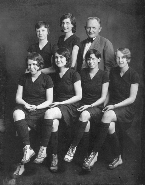 "Maxie Snead played on the 1929 Nashville Public School girls basketball team, nicknamed the ""Nashville Wonder Six"". For the three seasons 1927, 1928, 1929, the team record was 70 wins against only 4 losses. In 1927 they went 20-0 and won the Southeast Georgia Championship, also winning the Southeast Georgia Championship in 1928 and 1929. Seated left to right: Ida Lou Giddens Fletcher, Nell Powell McCloud, Silvia Bonnett, Evelyn Carter Wilkes. Standing: Maxie Snead Patten, Bill Griffin Register, and Coach Willie Chisholm. Image courtesy of www.berriencountyga.com"