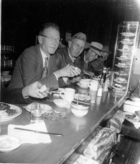 Leon Bradford and W. B. Parrish, February, 1951, at the diner in Nashville, GA. Leon Bradford owned a barbershop in Ray City.