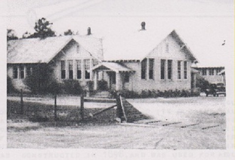 Fence and cattle gap in front of the Ray City School kept livestock out of the schoolyard, 1949.
