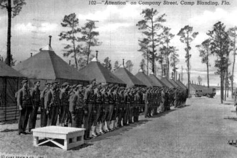 Soldiers at attention on Company Street at Camp Blanding - Starke, Florida. 1942. State Archives of Florida, Florida Memory. .