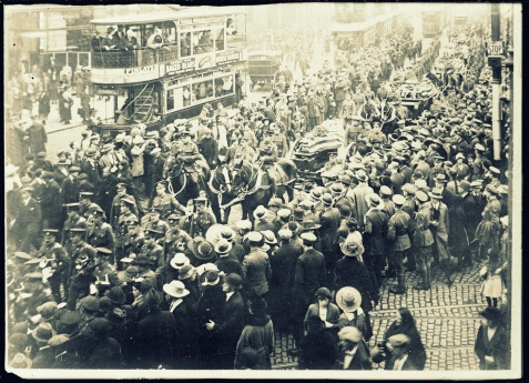 An American military funeral in Belfast, Ireland. On Oct. 11, a public funeral was held in Belfast for twelve American soldiers, victims of the Otranto disaster, and men who died from pneumonia after being landed in Ireland from a troopship. The march through the city, from the Victoria barracks to the City Cemetary. Everywhere the streets were crowded with people who had gathered to pay tribute to the honored dead. The coffins were carried on open hearses, two on each conveyance, with a guard of honor composed of British soldiers, marching beside the coffins, each of which was covered with an American flag http://hdl.loc.gov/loc.pnp/anrc.10185a