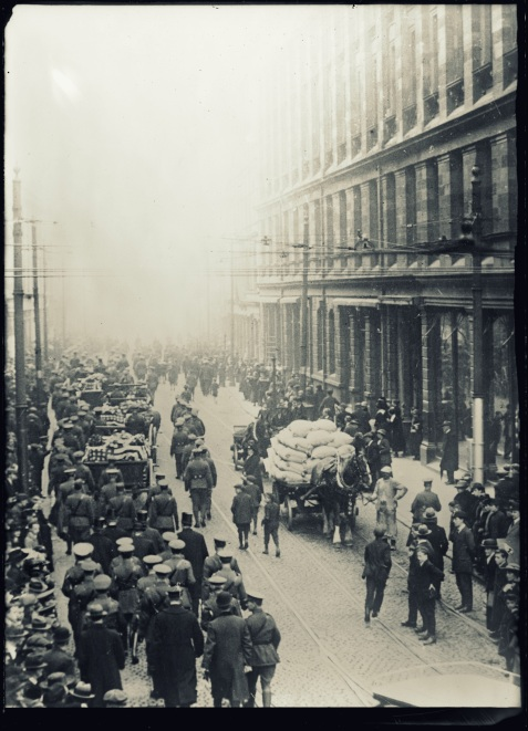 An American military funeral in Belast, Ireland. On Oct. 11, twelve American soldiers, victims of the Otranto and also several pneumonia cases, were buried in the City Cemetary. The band of mourners who marched behind the coffins included representatives of the American and British army and navy, of the Red Cross, and various local civic organizations. There was also the Lord Mayor, the American Consul and others http://hdl.loc.gov/loc.pnp/anrc.10186a