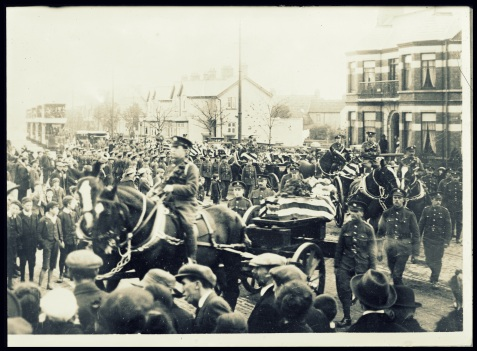 An American military funeral in Belfast, Ireland. On Oct. 11, twelve American soldiers, victims of the Otranto and also several pneumonia cases, were buried in the City Cemetery. British soldiers formed the guard of honor for the coffins, as they were carried through the principal streets of Belfast. The photograph shows the procession entering the gates of the cemetery http://hdl.loc.gov/loc.pnp/anrc.10187a