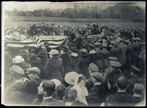 <br /> An American military funeral at Belfast, Ireland. Reading the funeral service for twelve American soldiers in the City Cemetery. The officiating clergymen were the Rev. William Maguire and the Rev. Father O'Kelly, CC. Eight of the soldiers belonged to the Roman Catholic Church, three to the Methodist church, one to the Baptist. American and British army officers and American Red Cross officers were the official chief mourners<br /> http://hdl.loc.gov/loc.pnp/anrc.10188a