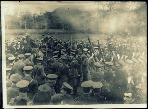 An American military funeral at Belfast, Ireland. Firing squad from the British army (Northumberland Fusiliers) fires the last salute at the graveside. The funeral was of twenty American soldiers on Oct. 11. Part of the men were victims of the Otranto disaster, others were men who died of pneumonia in Belfast hospitals shortly after arriving in Europe http://hdl.loc.gov/loc.pnp/anrc.10190a
