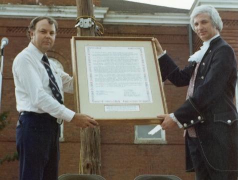 WD Knight presents Nashville, GA City Charter to Mayor Bobby Carroll during Bicentennial Celebration, July 4, 1976. Image courtesy of www,berriencountyga.com