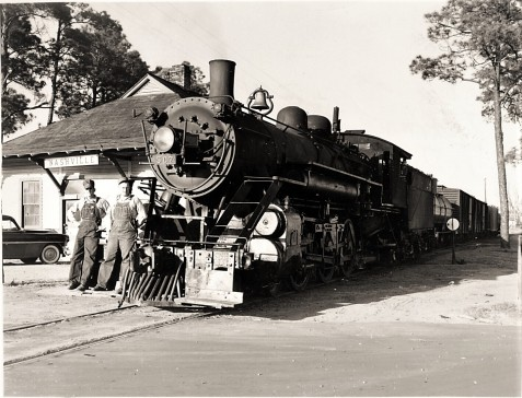 T.J. Sutton and Ed Benton with Georgia and Florida Railroad Engine No. 507 at the depot in Nashville, GA, March 24, 1955. Image courtesy of www.berriencountyga.com