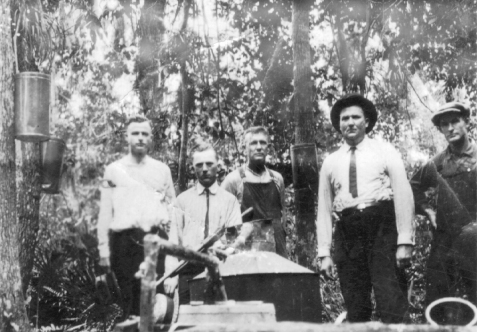Moonshine still bust about 1930 near Glory, GA on the Alapaha River . Chief of Police, Bruner Shaw, 2nd from the right. Other identified is Brooker Shaw, brother of Chief Shaw, 2nd from the left.