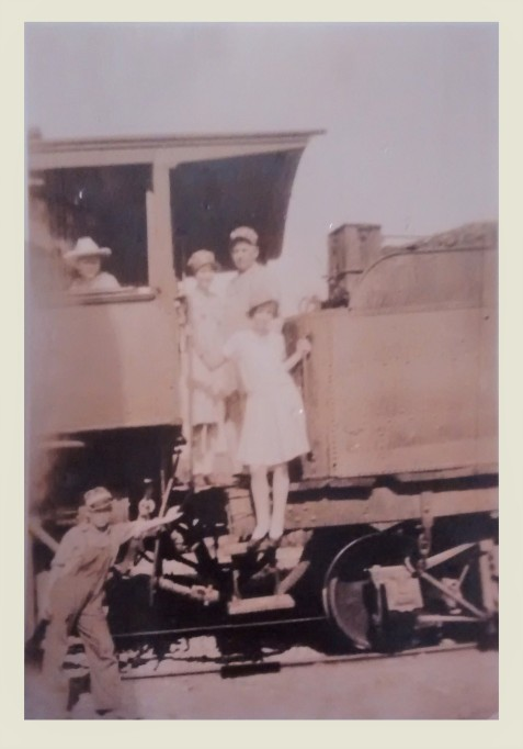 Railroad Engineer Thomas Babington McCauley and children, Harvey McCauley, Jeanette McCauley, Marion McCauley, and Thomas Jr., on a Georgia & Florida Railroad locomotive, probably photographed 1919 or early  1920.