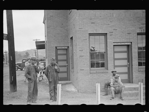 """Segregated Train Stations <br /> Signs above the doors at a Georgia railroad station in 1938, read """"Colored Men"""" and """"Colored Waiting Room."""" Image courtesy of Library of Congress."""