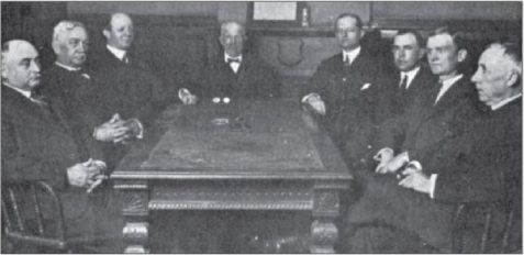 1889 Board of Directors, Merchants Bank of Valdosta. Left to right: The original board members of the bank included H. Y. Tillman, Edward Peck Smith Denmark, Mills B. Lane, Remer Young Lane, W. R. Strickland, Lowndes W. Shaw, Frank Strickland, unidentified.