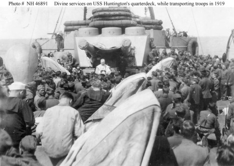 Devine services on USS Huntington's quarterdeck, while transporting troops in 1919. Henry Elmo Delaney and the other soldiers of the 57th Artillery CAC were among the first contingent of troops to be transported home by the Huntington.