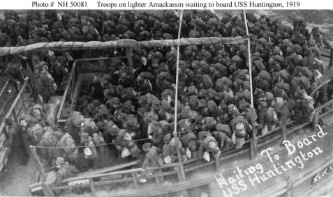 Troops on board the lighter Amackassin, waiting to board Huntington for their passage home from France, 1919.