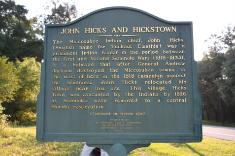 The Miccosukee Indian chief, John Hicks, (English name for Tuckose Emathla) was a prominent Indian leader in the period between the First and Second Seminole Wars (1818-1835). It is believed that after General Andrew Jackson destroyed the Miccosukee towns to the west of here in the 1818 campaign against the Seminoles, John Hicks relocated his village near this site. This village, Hicks Town, was evacuated by the Indians by 1826 as Seminoles were removed to a central Florida reservation. John Hicks died in the winter of 1833-34 after a decade as a major spokesman for his people in treaty councils in which important decisions about the future of the Seminoles were made. White settlers occupied the site in the late 1820's, and in 1830, Hickstown Post Office was established. By the late 1830's, the village had disappeared as a center of population due to the Second Seminole War and the creation of an official Madison County seat at San Pedro. Image source: https://www.waymarking.com/